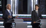 Liberal leader Justin Trudeau, right,  looks on as Conservative leader Erin O'Toole speaks during the federal election French-language leaders debate, Wednesday, Sept. 8, 2021, in Gatineau, Quebec. (Justin Tang/The Canadian Press via AP)