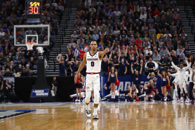 Gonzaga guard Geno Crandall (0) points to a teammate during the first half of a second-round game against Baylor in the NCAA men's college basketball tournament Saturday, March 23, 2019, in Salt Lake City. (AP Photo/Jeff Swinger)
