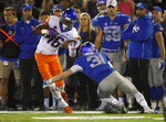 Boise State wide receiver John Hightower, left, is tackled by Air Force defensive back Ross Connors after pulling in a pass in the second half of an NCAA college football game Saturday, Oct. 27, 2018, at Air Force Academy, Colo. (AP Photo/David Zalubowski)