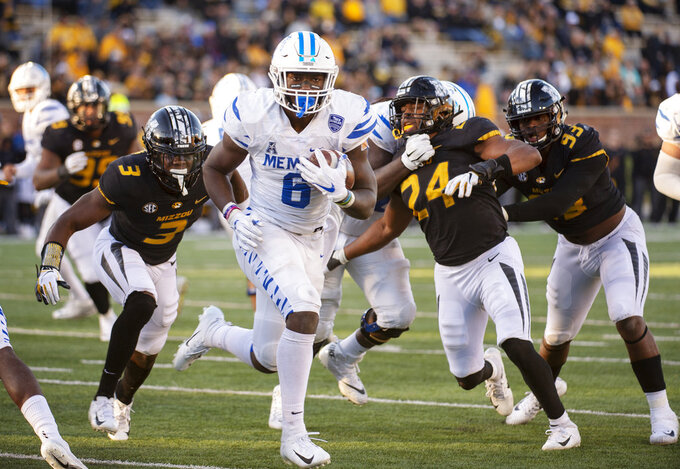 Memphis running back Patrick Taylor Jr. scrambles past Missouri defenders for a touchdown during the second half of an NCAA college football game Saturday, Oct. 20, 2018, in Columbia, Mo. Missouri won the game 65-33. (AP Photo/L.G. Patterson)