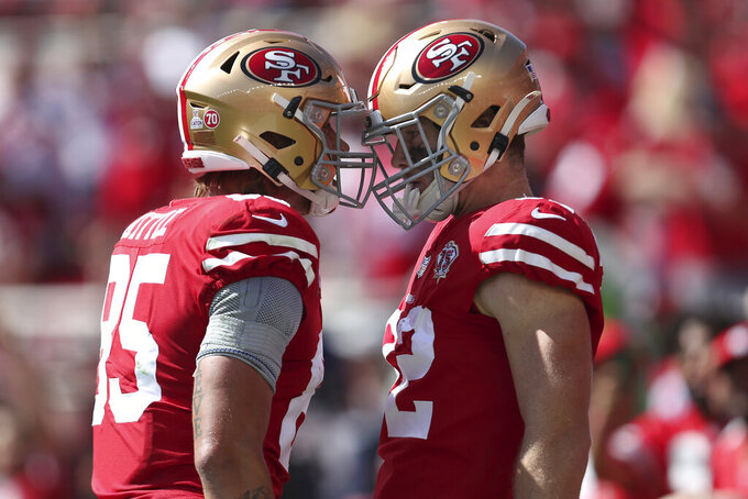 San Francisco 49ers tight end Ross Dwelley, right, is congratulated by George Kittle after catching a touchdown pass against the Seattle Seahawks during the first half of an NFL football game in Santa Clara, Calif., Sunday, Oct. 3, 2021. (AP Photo/Jed Jacobsohn)