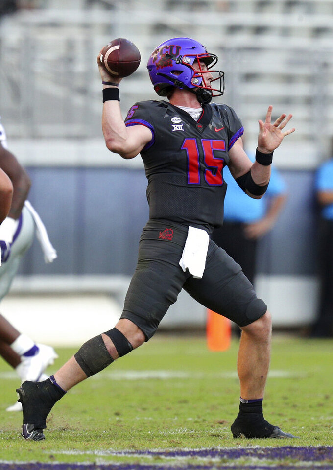 TCU quarterback Max Duggan (15) looks for an open receiver in an NCAA college football game against Kansas State, Saturday, Oct. 10, 2020, in Fort Worth, Texas. (AP Photo/Richard W. Rodriguez)
