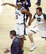 Michigan State guards Cassius Winston (5) and Foster Loyer celebrate the team's 75-63 win over Michigan in an NCAA college basketball game Saturday, March 9, 2019, in East Lansing, Mich. (AP Photo/Carlos Osorio)