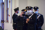 Carabinieri police officers wear face masks to curb the spread of COVID-19 as they stand inside a specially constructed bunker hosting the first hearing of a maxi-trial against more than 300 defendants of the 'ndrangheta crime syndicate, near the Calabrian town of Lamezia Terme, southern Italy, Wednesday, Jan. 13, 2021. A maxi-trial opened Wednesday in southern Italy against the 'ndrangheta crime syndicate, arguably the world's richest criminal organization that quietly amassed power in Italy as the Sicilian Mafia lost its influence. (Valeria Ferraro/LaPresse via AP)