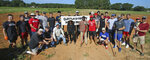 Members of the Gardner-Webb University baseball team and others pose for a group photo for the Cleveland County Potato Project in a potato field on Hamrick Road, Saturday, Sept. 4, 2021, in Shelby, N.C. When Doug Sharp founded the Cleveland County Potato Project 12 years ago, he had no idea his organization would reach more than 1 million pounds of distribution. Much of his ability to reach such an astronomical number stems from volunteers within the community. (Mike Hensdill/The Gaston Gazette via AP)
