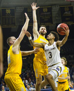 Notre Dame's Prentiss Hubb (3) drives against Luke Knapke (30) and Dylan Alderson during an NCAA college basketball game Thursday, Nov. 21, 2019, in South Bend, Ind. (Michael Caterina/South Bend Tribune via AP)