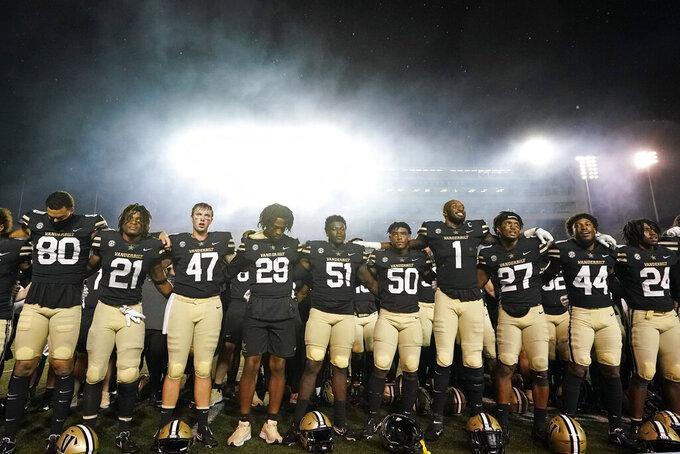 Vanderbilt players celebrate after beating Connecticut 30-28 in an NCAA college football game Saturday, Oct. 2, 2021, in Nashville, Tenn. (AP Photo/Mark Humphrey)