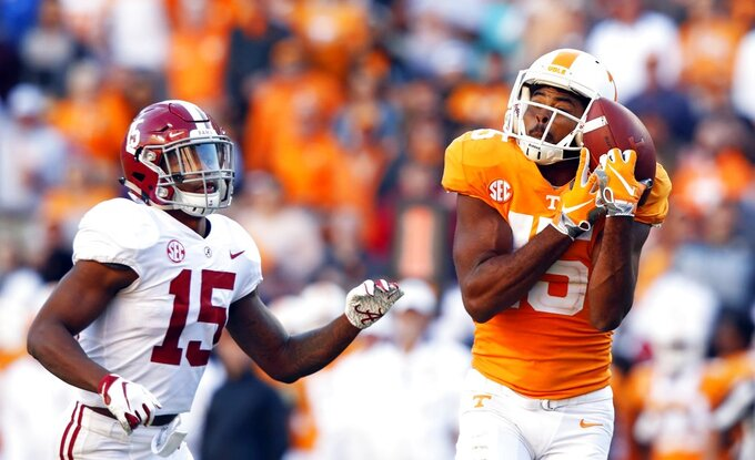 Tennessee wide receiver Jauan Jennings (15) catches a pass as he's defended by Alabama defensive back Xavier McKinney (15) in the first half of an NCAA college football game Saturday, Oct. 20, 2018, in Knoxville, Tenn. (AP Photo/Wade Payne)
