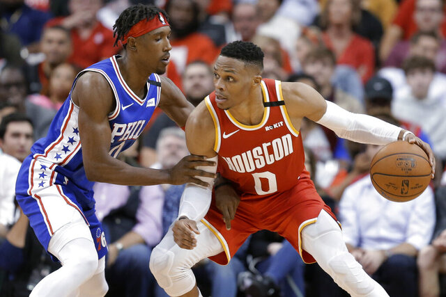 Houston Rockets guard Russell Westbrook (0) dribbles as Philadelphia 76ers guard Josh Richardson defends during the second half of an NBA basketball game Friday, Jan. 3, 2020, in Houston. (AP Photo/Eric Christian Smith)
