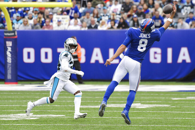 New York Giants quarterback Daniel Jones (8) catches a pass in front of Carolina Panthers' Sean Chandler (34) during the second half of an NFL football game, Sunday, Oct. 24, 2021, in East Rutherford, N.J. (AP Photo/Bill Kostroun)