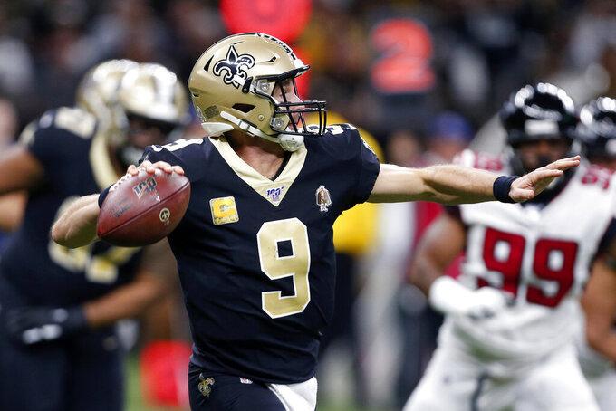 New Orleans Saints quarterback Drew Brees (9) scrambles in the first half of an NFL football game against the Atlanta Falcons in New Orleans, Sunday, Nov. 10, 2019. (AP Photo/Butch Dill)