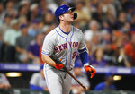 New York Mets' Pete Alonso watches his solo home run off Colorado Rockies pitcher Tim Melville during the sixth inning of a baseball game Tuesday, Sept. 17, 2019, in Denver. (AP Photo/David Zalubowski)