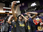 Liberty players celebrate after beating Lipscomb in the Atlantic Sun NCAA college basketball tournament championship game Sunday, March 10, 2019, in Nashville, Tenn. Liberty won 74-68. (AP Photo/Mark Humphrey)