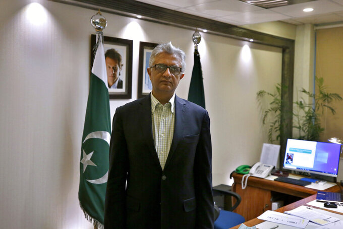 Pakistan's top health official Faisal Sultan poses for photograph at his office in Islamabad, Pakistan, Monday, May 24, 2021. Sultan who is overseeing the country's response to coronavirus said Monday the new COVID-19 variant that devastated neighboring India by causing record infections and deaths had not been found in Pakistan yet. (AP Photo/Anjum Naveed)