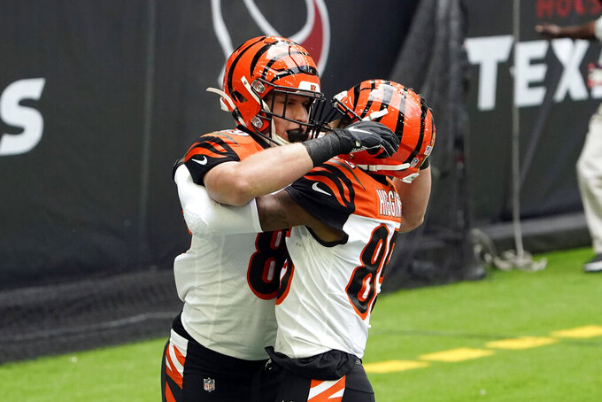 Cincinnati Bengals tight end Drew Sample, left, celebrates with Tee Higgins after catching a pass for a touchdown against the Houston Texans during the first half of an NFL football game Sunday, Dec. 27, 2020, in Houston. (AP Photo/Sam Craft)