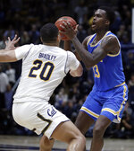 UCLA's Kris Wilkes, right, looks to shoot as California's Matt Bradley defends during the second half of an NCAA college basketball game Wednesday, Feb. 13, 2019, in Berkeley, Calif. (AP Photo/Ben Margot)