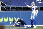 Seattle Seahawks wide receiver DK Metcalf, left, and Dallas Cowboys cornerback Trevon Diggs, right, react after Diggs knocked the ball loose from Metcalf's hands after a pass reception near the end zone during the first half of an NFL football game, Sunday, Sept. 27, 2020, in Seattle. (AP Photo/Elaine Thompson)