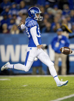 FILE - In this Oct. 20, 2018, file photo, Kentucky punter Max Duffy (93) punts the ball during the first half of an NCAA college football game against Vanderbilt, in Lexington, Ky. Duffy was selected to The Associated Press preseason All-America first-team, Tuesday, Aug. 25, 2020. (AP Photo/Bryan Woolston, File)