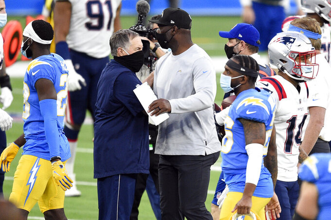 New England Patriots head coach Bill Belichick, center left, shakes hands with Los Angeles Chargers head coach Anthony Lynn at the end of an NFL football game Sunday, Dec. 6, 2020, in Inglewood, Calif. (AP Photo/Kelvin Kuo)