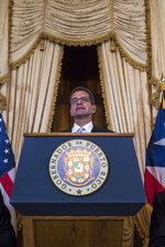Pedro Pierluisi, sworn in as Puerto Rico's governor, attends a press conference in San Juan, Puerto Rico, Friday, Aug. 2, 2019. Departing Puerto Rico Gov. Ricardo Rossello resigned as promised on Friday and swore in Pierluisi, a veteran politician as his replacement, a move certain to throw the U.S. territory into a period of political chaos that will be fought out in court. (AP Photo/Dennis M. Rivera Pichardo)