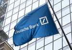 FILE - In this Friday, Oct. 7, 2016, file photo, a flag for Deutsche Bank flies outside the German bank's New York offices on Wall Street. Manhattan District Attorney Cyrus Vance Jr., the New York prosecutor who has been fighting to get President Donald Trump's tax returns, got Deutsche Bank in 2019 to turn over other Trump financial records. (AP Photo/Mark Lennihan, File)