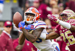 Florida State defensive back Asante Samuel Jr. (26) breaks up a pass intended for Florida wide receiver Tyrie Cleveland in the first half of an NCAA college football game in Tallahassee, Fla., Saturday, Nov. 24, 2018. (AP Photo/Mark Wallheiser)