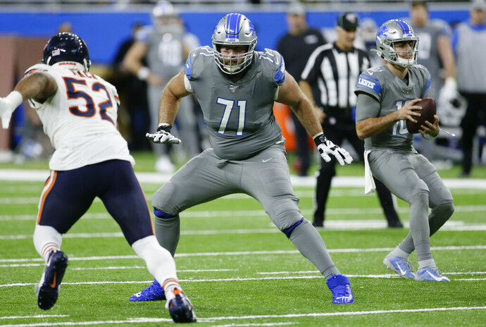FILE - This Nov. 28, 2019, file photo shows Detroit Lions offensive tackle Rick Wagner (71) blocking for quarterback David Blough, right, against Chicago Bears outside linebacker Khalil Mack (52) during the second half of an NFL football game in Detroit. Wagner, now an offensive tackle for the Green Bay Packers, has a tough assignment as he returns to his home state. The West Allis native and former Wisconsin lineman is getting the first shot to emerge as Green Bay's right tackle, a spot where Bryan Bulaga had been a fixture for a decade before signing with the Los Angeles Chargers. (AP Photo/Duane Burleson, File)