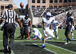 Air Force quarterback Donald Hammond III flips the ball to umpire Michael Cooper after rushing for a touchdown against Colorado in the first half of an NCAA college football game Saturday, Sept. 14, 2019, in Boulder, Colo. (AP Photo/David Zalubowski)