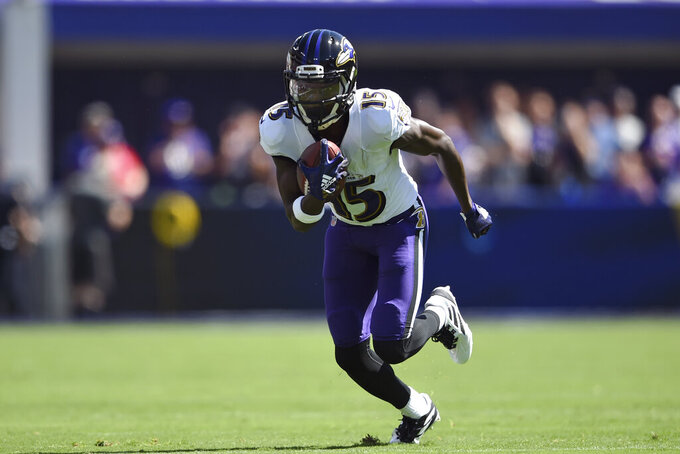Baltimore Ravens wide receiver Marquise Brown rushes the ball in the first half of an NFL football game against the Arizona Cardinals, Sunday, Sept. 15, 2019, in Baltimore. (AP Photo/Gail Burton)