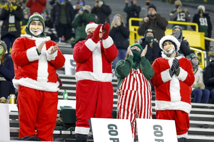 A limited number of fans watch during the first half of an NFL football game between the Green Bay Packers and the Carolina Panthers Saturday, Dec. 19, 2020, in Green Bay, Wis. (AP Photo/Mike Roemer)