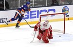 Detroit Red Wings goaltender Jimmy Howard (35) skates away from the net after New York Islanders' Anders Lee (27) scored during overtime in a preseason NHL hockey game Monday, Sept. 23, 2019, in Uniondale, N.Y. (AP Photo/Kathleen Malone-Van Dyke)