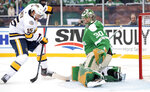 Dallas Stars goaltender Ben Bishop (30) blocks the shot of Nashville Predators right wing Craig Smith (15) in the first period of the NHL Winter Classic hockey game at the Cotton Bowl, Wednesday, Jan. 1, 2020, in Dallas. (AP Photo/Jeffrey McWhorter)