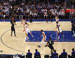 New York Knicks' Derrick Rose (4) shoots as Atlanta Hawks' Bogdan Bogdanovic (13) defends during Game 2 in an NBA basketball first-round playoff series Wednesday, May 26, 2021, in New York. (Elsa/Pool Photo via AP)