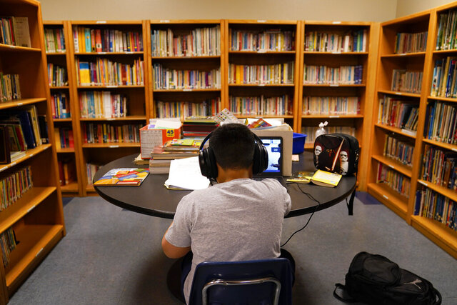 FILE - In this Aug. 26, 2020 file photo, a Los Angeles Unified School District student attends an online class at Boys & Girls Club of Hollywood in Los Angeles. A group of nine parents is filing a lawsuit Thursday, Aug. 24, 2020 alleging the Los Angeles Unified School District's distance learning program since the pandemic has failed to meet state standards or guarantee a basic education and disproportionately harms Black and Latino students. (AP Photo/Jae C. Hong, File)