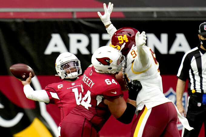 Arizona Cardinals quarterback Kyler Murray (1) throws as offensive guard J.R. Sweezy (64) blocks Washington Football Team nose tackle Daron Payne (94) pursues during the first half of an NFL football game, Sunday, Sept. 20, 2020, in Glendale, Ariz. (AP Photo/Ross D. Franklin)