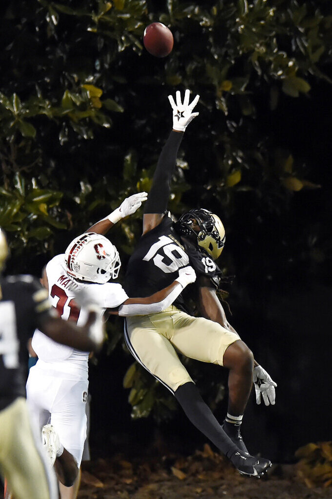Vanderbilt wide receiver Chris Pierce Jr. (19) reaches for a pass as he is defended by Stanford cornerback Zahran Manley (31) during the second half of an NCAA college football game Saturday, Sept. 18, 2021, in Nashville, Tenn. (AP Photo/Mark Zaleski)