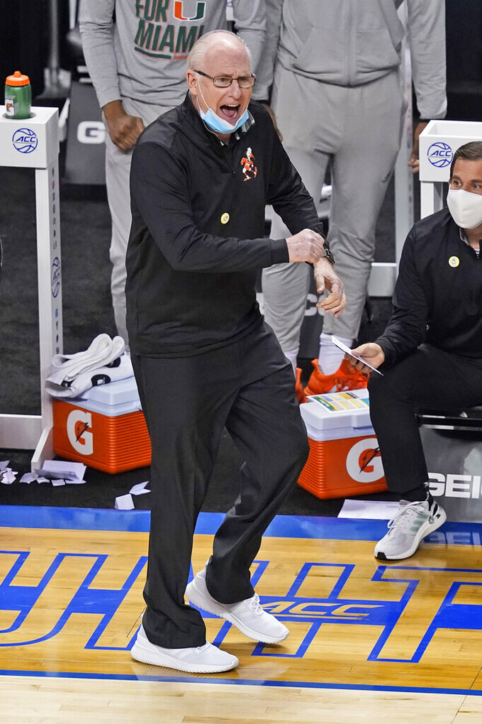 Miami head coach Jim Larranaga directs his team during the first half of an NCAA college basketball game against Clemson in the second round of the Atlantic Coast Conference tournament in Greensboro, N.C., Wednesday, March 10, 2021. (AP Photo/Gerry Broome)