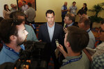 New York Mets general manager Brodie Van Wagenen, center, speaks to reporters during the baseball general managers meetings Wednesday, Nov. 7, 2018, in Carlsbad, Calif. (AP Photo/Gregory Bull)