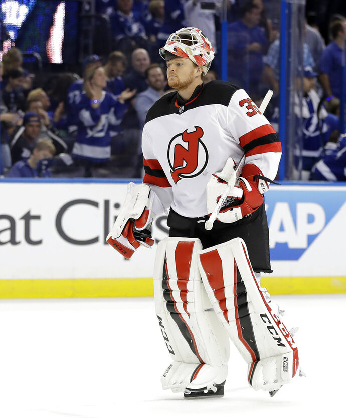 New Jersey Devils goaltender Cory Schneider (35) replaces Keith Kinkaid in the net during the second period of Game 2 of an NHL first-round hockey playoff series against the Tampa Bay Lightning, Saturday, April 14, 2018, in Tampa, Fla. (AP Photo/Chris O'Meara)