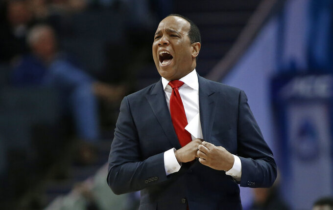 North Carolina State head coach Kevin Keatts directs his team against Clemson during the first half of an NCAA college basketball game in the Atlantic Coast Conference tournament in Charlotte, N.C., Wednesday, March 13, 2019. (AP Photo/Nell Redmond)
