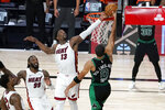 Miami Heat's Jimmy Butler, bottom left, and Jae Crowder (99) look on as Bam Adebayo (13) blocks a shot attempt by Boston Celtics' Jayson Tatum (0) in the closing seconds of overtime of an NBA conference final playoff basketball game, Tuesday, Sept. 15, 2020, in Lake Buena Vista, Fla. (AP Photo/Mark J. Terrill)