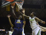 Baylor guard Mark Vital, right, reaches in on West Virginia forward Andrew Gordon, left, white attempting to score in the second half of an NCAA college basketball game, Saturday, Feb. 23, 2019, in Waco, Texas. Baylor won 82-75. (Ernesto Garcia/Waco Tribune-Herald via AP)