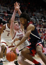 Arizona's Zeke Nnaji, right, drives the ball against Stanford's James Keefe during the second half of an NCAA college basketball game Saturday, Feb. 15, 2020, in Stanford, Calif. (AP Photo/Ben Margot)