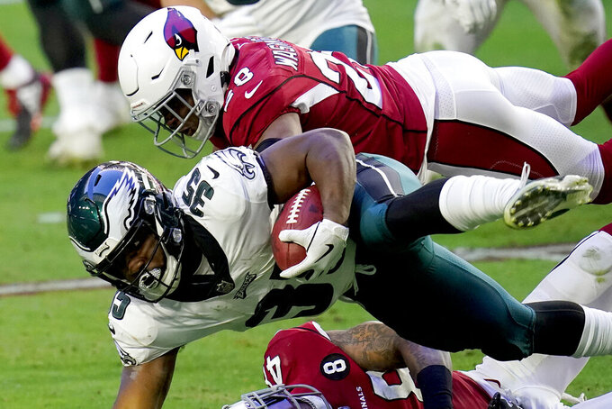 Philadelphia Eagles running back Boston Scott (35) is hit by Arizona Cardinals safety Charles Washington (28) during the second half of an NFL football game, Sunday, Dec. 20, 2020, in Glendale, Ariz. (AP Photo/Ross D. Franklin)