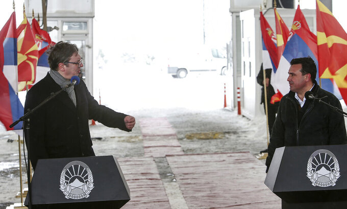 Serbia's President Aleksandar Vucic, left, and North Macedonia's Prime Minister Zoran Zaev, right, hold a news conference during a handover of COVID-19 vaccines, at the border crossing Tabanovce, between North Macedonia and Serbia, on Sunday, Feb. 14, 2021. Serbia which has launched a successful vaccination campaign has donated some 8,000 doses of Pfizer COVID-19 shots to North Macedonia which is yet to deliver its first shots. (AP Photo/Boris Grdanoski)