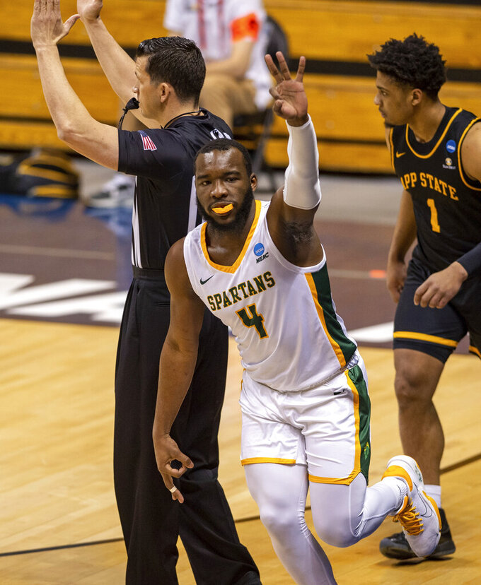 Norfolk State guard Joe Bryant Jr. (4) reacts after scoring a three-point basket during the first half of a First Four game against Appalachian State in the NCAA men's college basketball tournament, Thursday, March 18, 2021, in Bloomington, Ind. (AP Photo/Doug McSchooler)