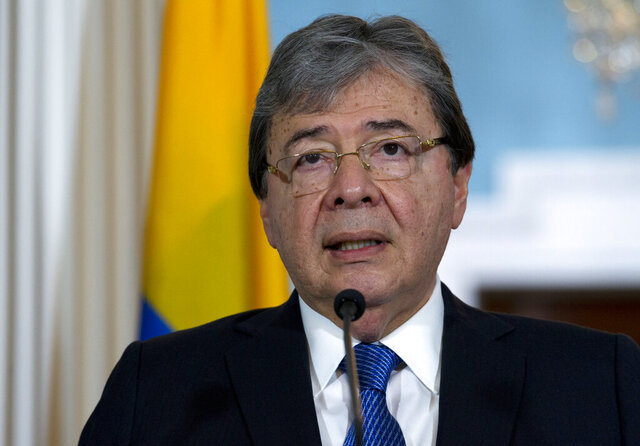 "FILE - In this Oct. 9, 2019 file photo, Colombian Foreign Minister Carlos Holmes Trujillo speaks to reporters after a bilateral meeting at the Department of State in Washington. Colombian officials say Defense Minister Carlos Holmes Trujillo has died from complications of COVID-19. He was 69. President Ivan Duque said in a statement that Holmes Trujillo died early Tuesday, Jan. 26, 2021 adding that he ""couldn't express the pain"" he was feeling over the news. (AP Photo/Jose Luis Magana, file)"