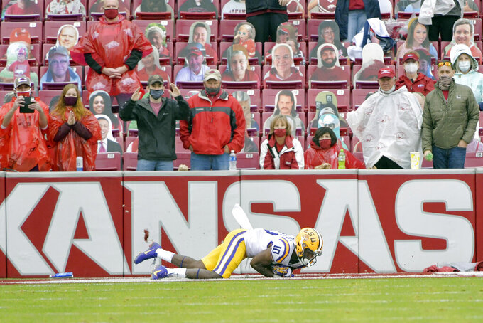 Arkansas fans react as LSU receiver Jaray Jenkins (10) catches a go-ahead touchdown pass in the second half of an NCAA college football game Saturday, Nov. 21, 2020, in Fayetteville, Ark. (AP Photo/Michael Woods)