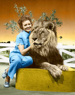 """This colorized image released by Margate And Chandler, Inc. shows actress and animal activist Betty White with a lion from her 1970s series """"The Pet Set."""