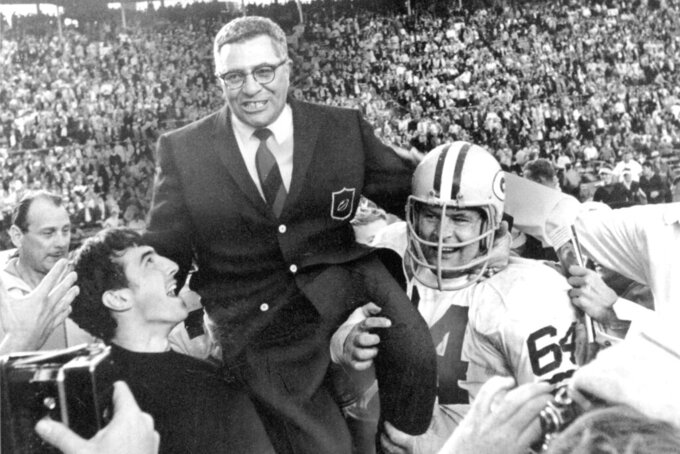 FILE - In this Jan. 14, 1968, file photo, Green Bay Packers coach Vince Lombardi is carried off the field after his team defeated the Oakland Raiders 33-14 in Super Bowl II in Miami, Fla. Packers guard Jerry Kramer (64) is at right. The Packers were the dominant team of the 1960s, winning NFL championships in 1961, '62 and '65 and then winning the NFL and the first two Super Bowls against the AFL champion Kansas City in the 1966 season and Oakland in the 1967 season with a roster that included 12 Hall of Famer players and coach Vince Lombardi. (AP Photo/File)